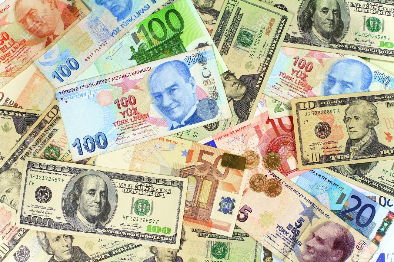 Background from dollars and euro bills. One hundred Turkish Lira banknote on other currencies